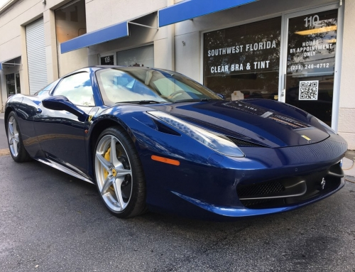 A Stunning Blue & White Ferrari In The Shop